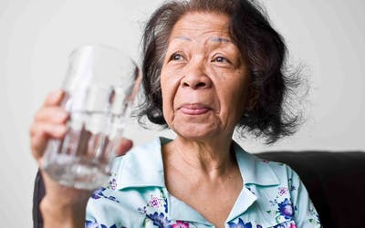 Healthy lungs tips to help quit smoking Woman holding a glass of water Oak Street Health